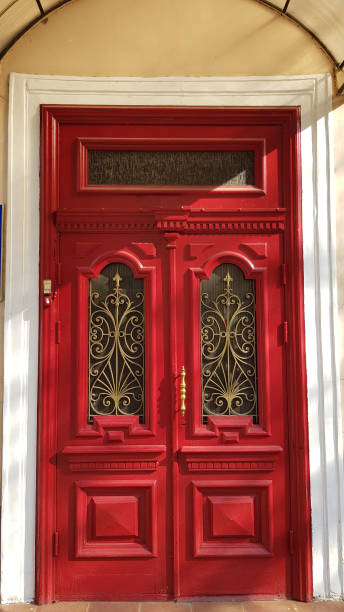 Entrance to ornate red door of historic building in European city Odessa of Ukraine stock photo