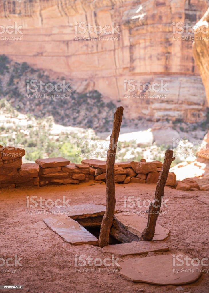 Entrance to restored underground Kiva of Pueblo cliff dwelling stock photo