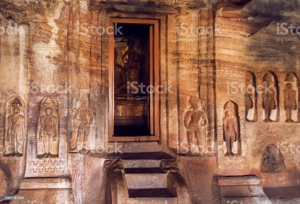 Entrance to sanctuary of the 7th century cave temple in Karnataka, India. Sculptures and carvings in old Indian style stock photo