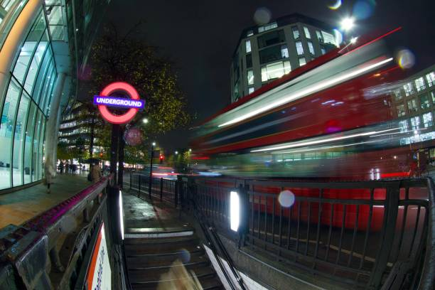 Entrance to St Pauls Underground Station, London Long exposure view of the iconic London Underground roundel at night, with London bus. skeable stock pictures, royalty-free photos & images
