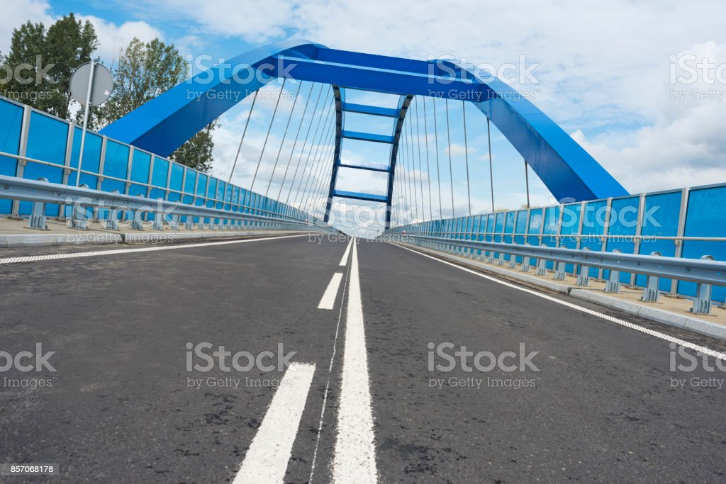 Entrance to the blue bridge, Low angle and tilt photo. stock photo