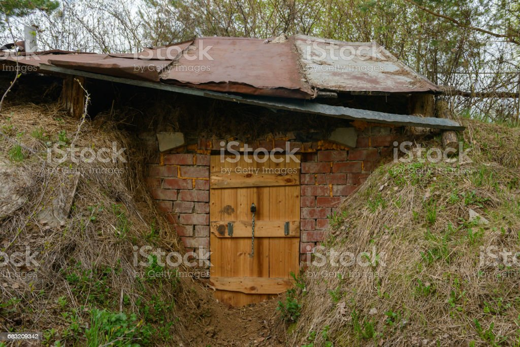 Entrance to the dugout on the slopes of the hills foto de stock royalty-free