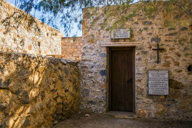 Entrance to the historic chapel at the cemetery on the leper island. Historic buildings in the Spinalonga fortress, Crete. – zdjęcie