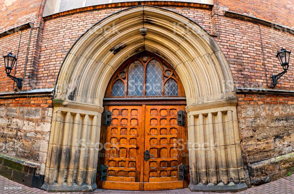 Entrance to the medieval church, Riga, Latvia stock photo