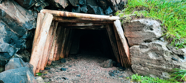 Entrance to the old tunnel made of wooden beams.