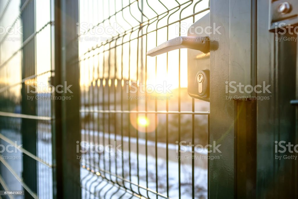 entrance to the playground of fence and the wicket of the welded wire mesh green royalty-free stock photo