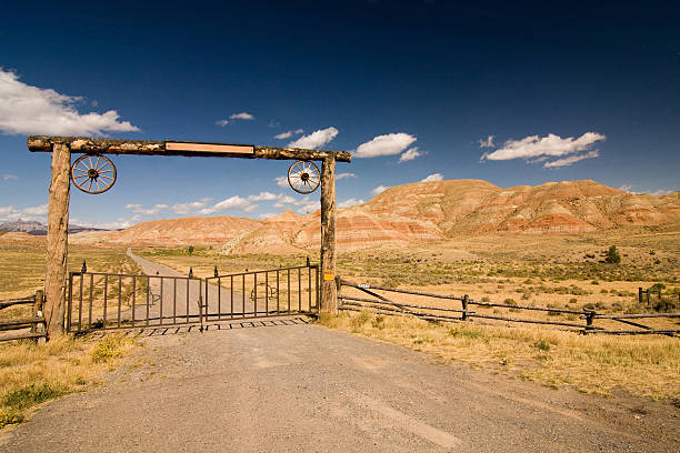 Entrance to the ranch Entrance to the ranch, wild west ranch stock pictures, royalty-free photos & images