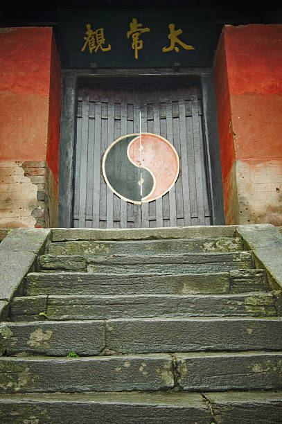 Entrance to the Temple Stairs to Old Temple in Wudangshan mountains. China.Chinese characters on a wall is not trademarked. taoism stock pictures, royalty-free photos & images