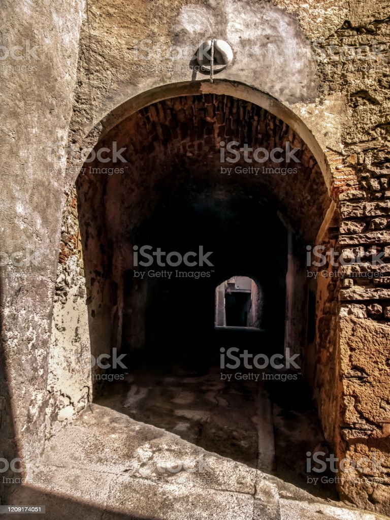 Entrance to the underground medieval street in Cervera town (Catalonia, Spain) Entrance to the underground medieval street in Cervera town (Catalonia, Spain). Narrow, low, ancient stone-walled tunnel Ancient Stock Photo
