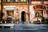 Warsaw, Poland - September 21, 2018:Entrance to restaurants traditional Polish Zachcianek and U Barssa. Restaurants located in the historic center of Warsaw's Old Town in Old Town Market Place