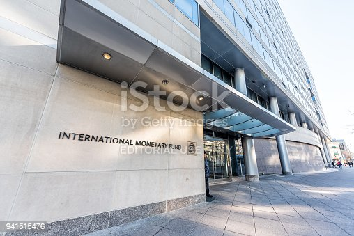 istock IMF entrance with sign of International Monetary Fund, concrete architecture building wall security guard doors 941515476