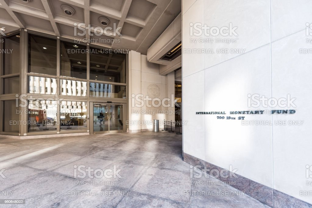 IMF entrance with sign of International Monetary Fund, concrete architecture building wall doors stock photo