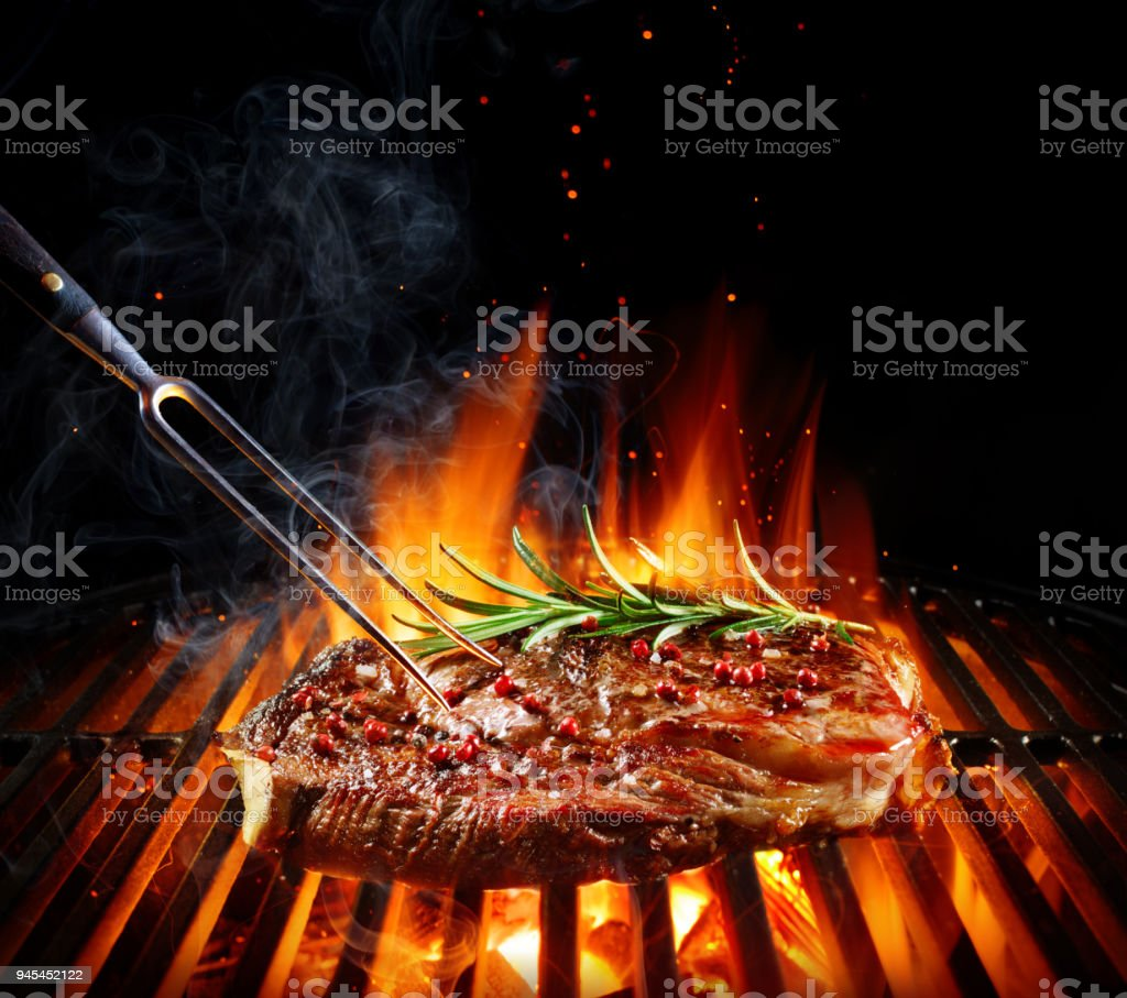 Entrecote Beef Steak On Grill With Rosemary Pepper And Salt stock photo