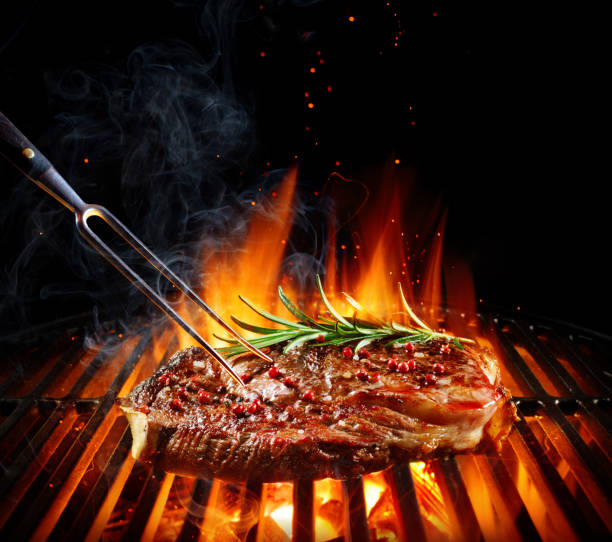 entrecote beef steak on grill with rosemary pepper and salt - barbecue grill stock photos and pictures