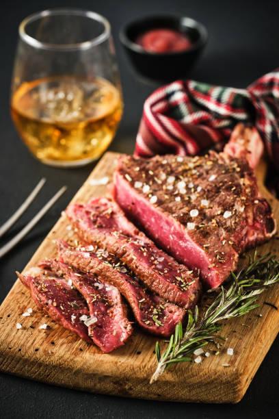 Cтоковое фото Entrecote. Steak on the bone. Rib eye. Tomahawk steak on the on a cutting board with rosemary. Roasting - Rare