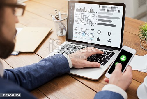 655652514 istock photo Entrepreneur analyzing graph on laptop at workplace 1224540054