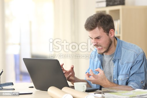 istock Entrepreneur angry and furious with laptop 536669536