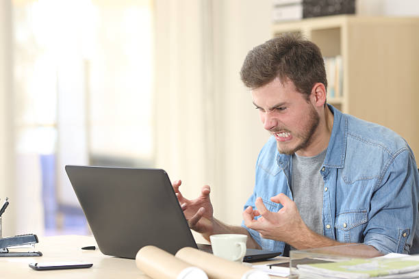 entrepreneur angry and furious with laptop - rudeness stock pictures, royalty-free photos & images