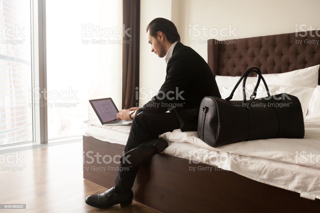 Entrepreneur checks presentation in hotel room stock photo