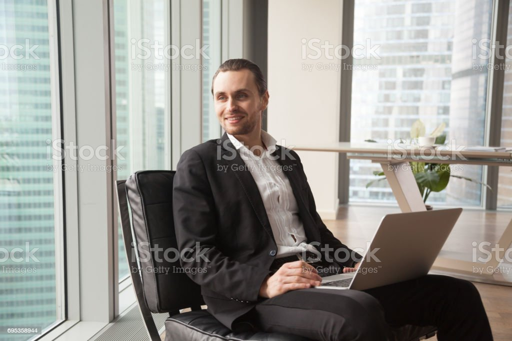 Entrepreneur dreaming about happy future in office stock photo