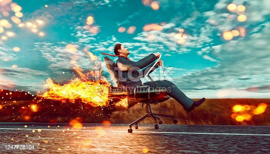 Concept of business growth and success. Man wears business suit and sits in an office chair which is connected to two rockets. He drives the office chair fast on a road and almost takes off. Note: The man is a 3D-render with face scan. Model release attached.