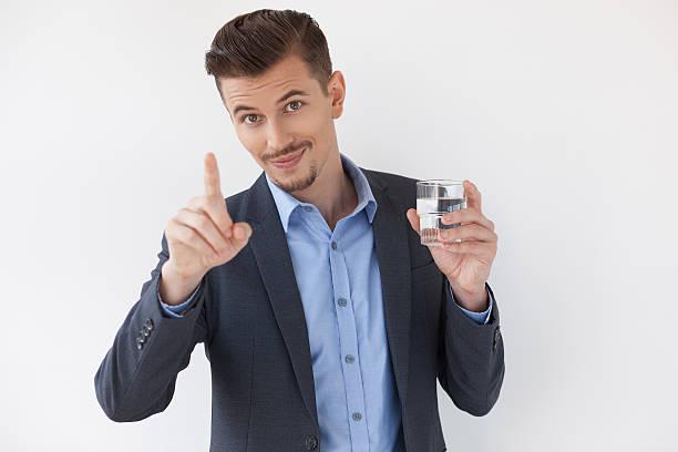 entrepreneur showing paying attention gesture - leitungswasser trinken stock-fotos und bilder