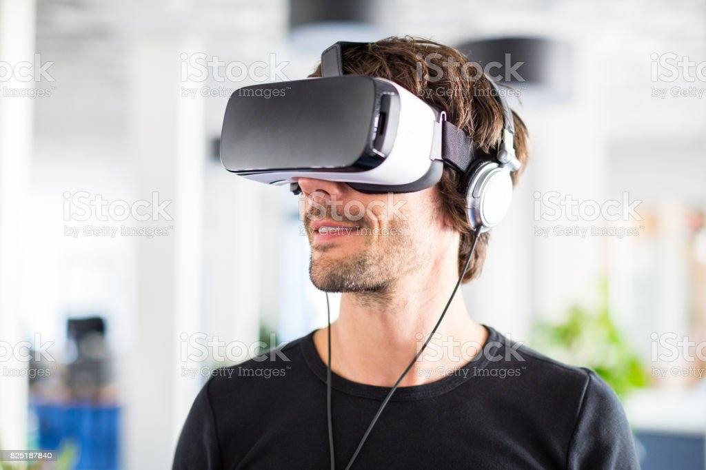 Entrepreneur testing virtual reality simulator headset stock photo