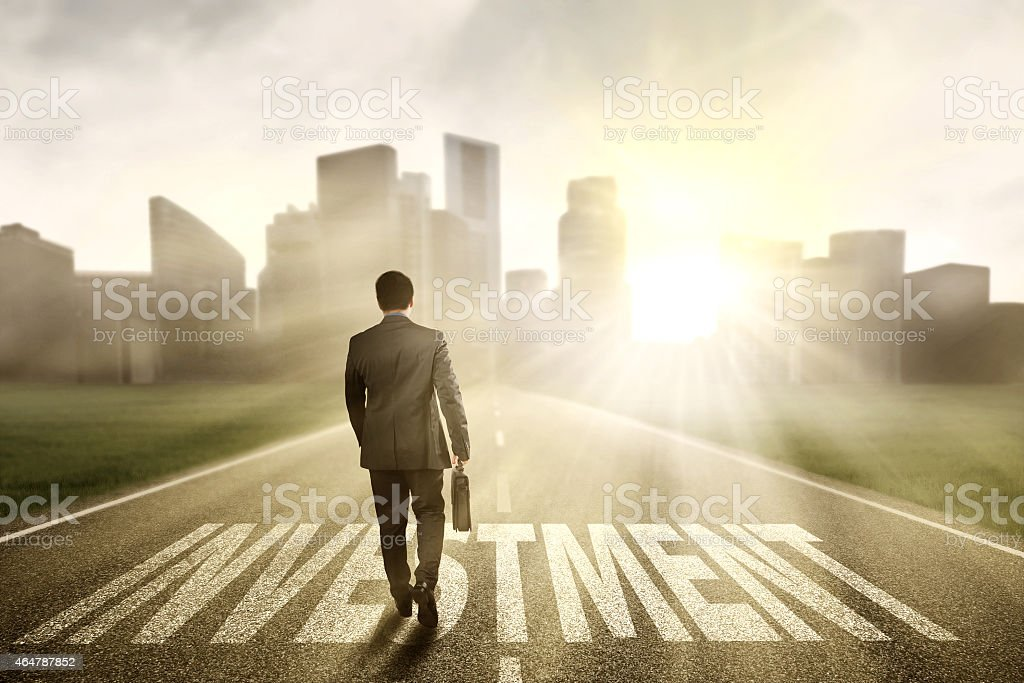Entrepreneur walking on the investment road stock photo