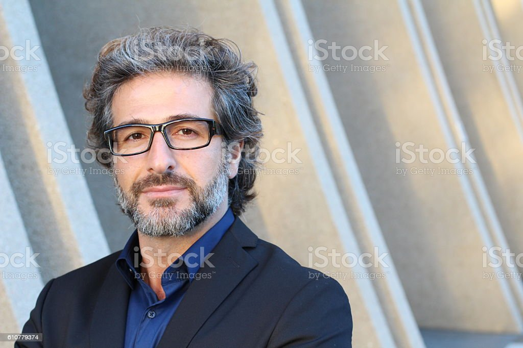 Entrepreneur with glasses standing outside stock photo