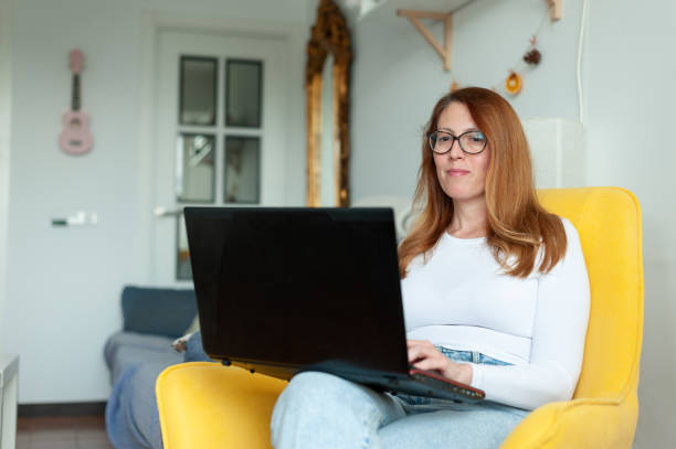 Entrepreneur woman working from home stock photo