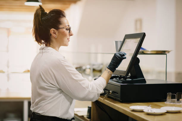 entrepreneur working at a POS terminal