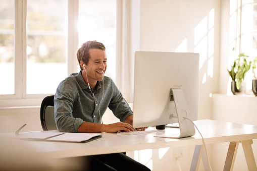 Entrepreneur Working On Computer At Home Stock Photo - Download Image Now