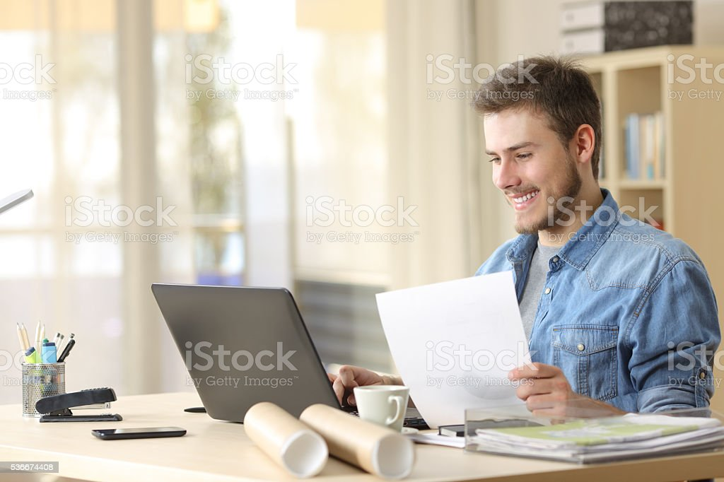 Entrepreneur working with laptop and document stock photo