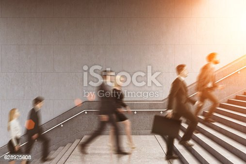 513121118istockphoto entrepreneurs climbing a stair in a building, toned 628925608