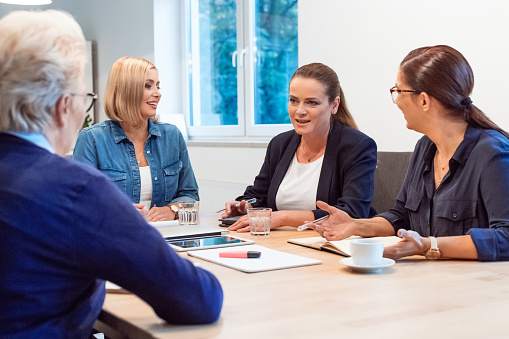 Entrepreneurs Discussing With Colleagues In Office Stock Photo - Download Image Now