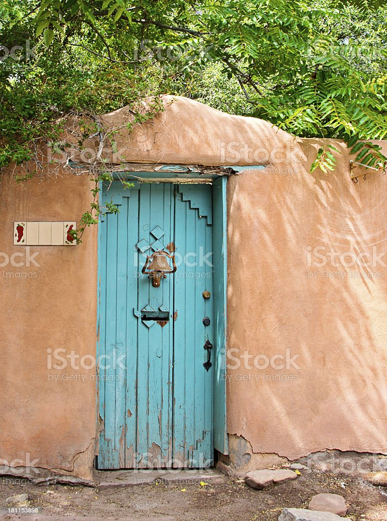 Entry Door to Southwest Santa Fe Adobe Stucco House royalty-free stock photo