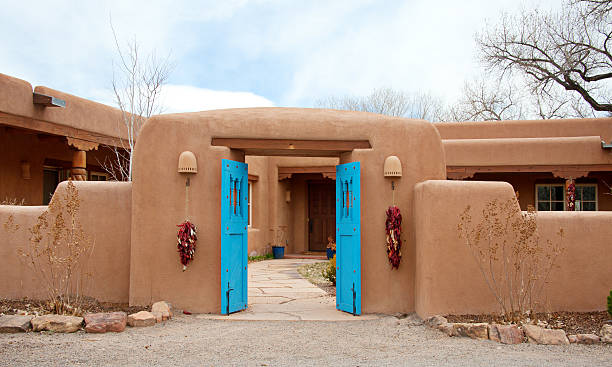 Entry Door to Southwest Santa Fe Pueblo-Style Adobe House stock photo