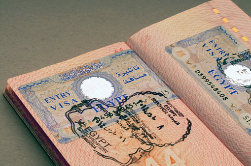 istock Entry Egyptian visa in the passport. Selective focus. Travel concept. 1128779089