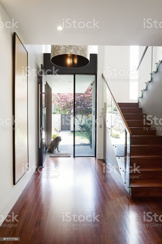 Entry foyer of architect designed modern Australian home with wooden floor stock photo