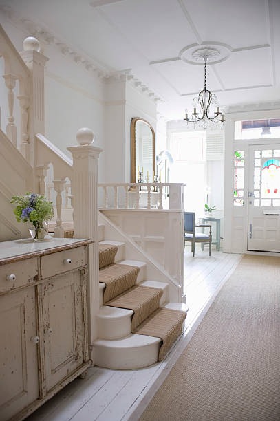 entry hall with stairway - carpet runner stock photos and pictures