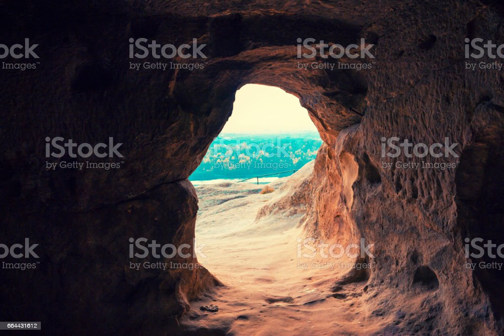 Entry into the cave in antique cave city Uplistsikhe, Georgia, Europe. stock photo