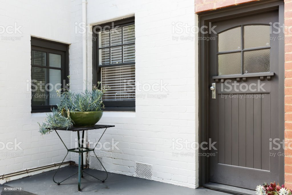 Entry porch and front door of an art deco style apartment stock photo