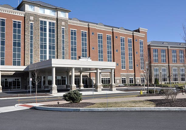 Entryway and facade of large hospital stock photo