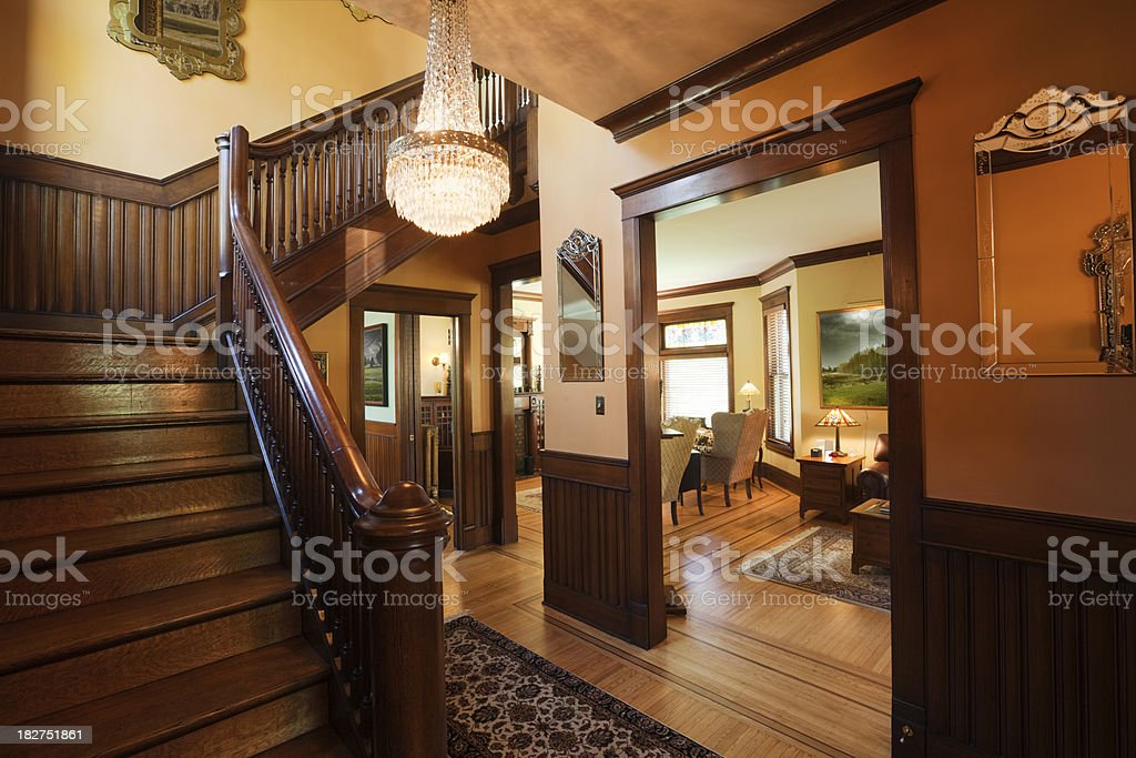Entryway Foyer and Staircase of Restored Renovated Victorian Home Interior stock photo
