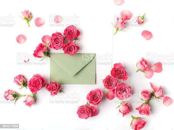 Envelop with white card and rose background flat lay top picture id564577656?b=1&k=6&m=564577656&s=612x612&h=l4vu8oosivi 4mtithvtlabut97sevbiphzvexeraog=