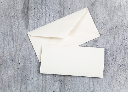 istock Envelope and card on wood background 622529172