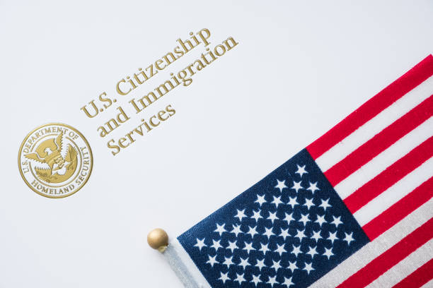 Envelope from U.S. Citizenship and Immigration Services with the American flag on top/U.S. immigration concept Envelope from U.S. Citizenship and Immigration Services with the American flag on top/U.S. immigration concept customs stock pictures, royalty-free photos & images