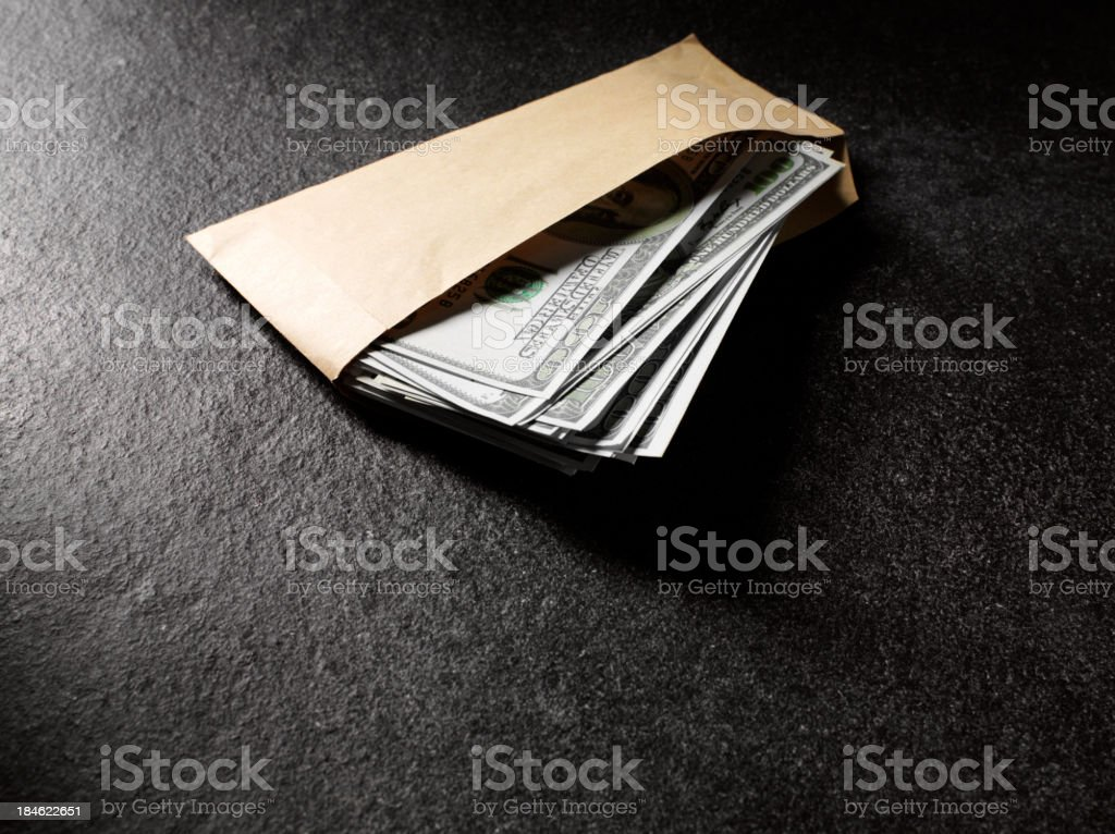 Envelope Full of American Dollars stock photo