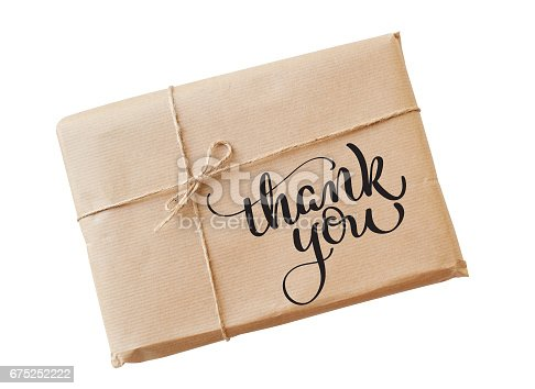 istock envelope kraft paper tied with string on a white background and text Thank you. Calligraphy lettering hand draw 675252222