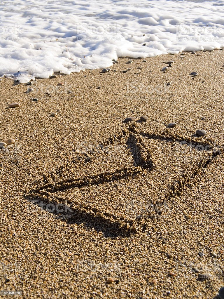 envelope on wet sea sand royalty-free stock photo